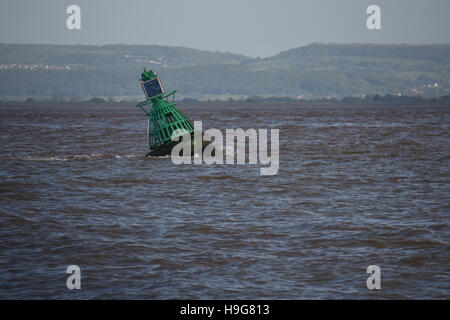 N Elbow buoy off Clevedon in the Bristol Channel being swept by the tide - Stock Photo