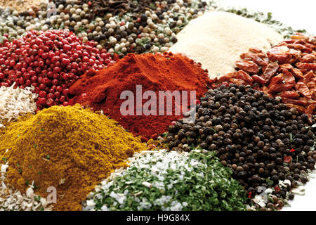 Various spices, peppercorns, bell pepper powder, curry powder - Stock Photo