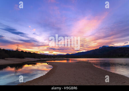 beautiful sunset on Lake , Manzanares del Real , Spain - Stock Photo