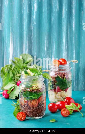 Salads with quinoa in jars - Stock Photo