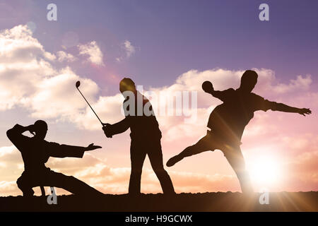 Composite image of rear view of sportsman throwing a shot - Stock Photo