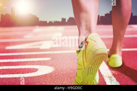 Composite image of close up of athletic feet against a white background - Stock Photo