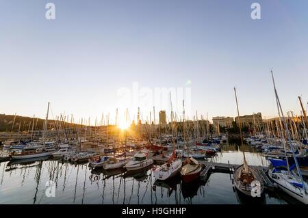 Barcelona, Spain - Oct.10 2011: Sunset over Port Vell in Barcelona. Port Vell is a waterfront harbor in Barcelona, - Stock Photo