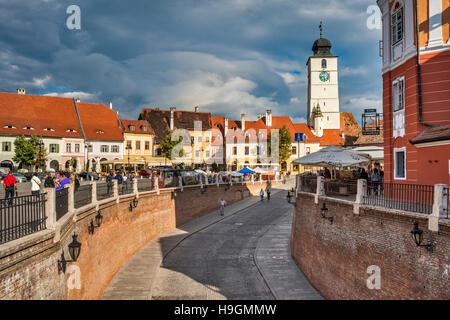Passage to Lower Town, City Hall Tower (Turnul Sfatului), from Liars Bridge (Podul Minciunilor) in Sibiu, Transylvania, - Stock Photo