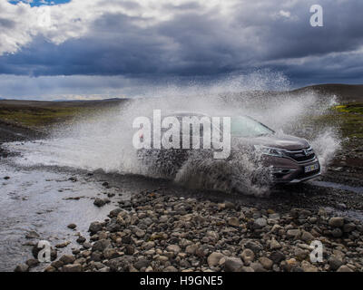 Driving through a river in a 4x4 - Stock Photo