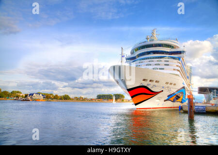 WARNEMUENDE / GERMANY - SEPTEMBER 21, 2013: cruise ship from AIDA lies in harbour warnemuende / germany. AIDA Cruises - Stock Photo