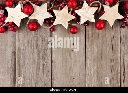 Christmas Border Design Rustic Top With Wood Star Ornaments And Baubles On An Aged Background