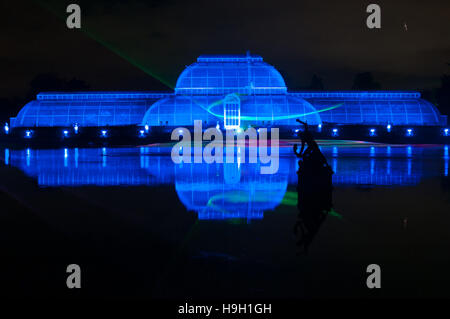 London, UK. 22nd November, 2016. The Palm House illuminated with laser beams for the Christmas at Kew Light Trail - Stock Photo