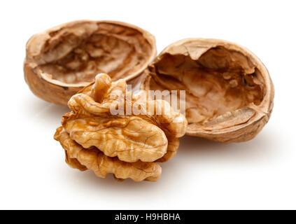 Peeled walnut and its kernels. Isolated on a white background - Stock Photo