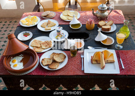 Moroccan breakfast in roof top restaurant of Riad Arabesque ind Fès - Stock Photo