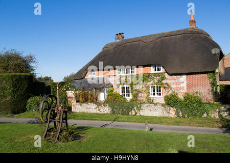 Thatched house in the village of Martin, Hampshire, UK - Stock Photo
