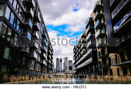 Sky and cloud reflections from residential buildings and watter at Montreal downtown. - Stock Photo