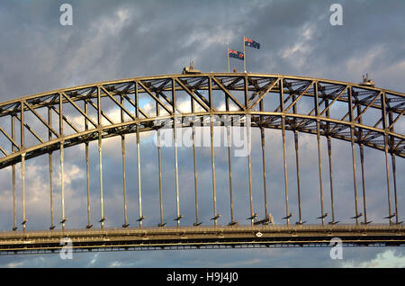 Sydney Harbour Bridge east side during sunrise in Sydney, Australia. - Stock Photo