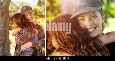 Composite image of a soldier mother hugging her daughter - Stock Photo