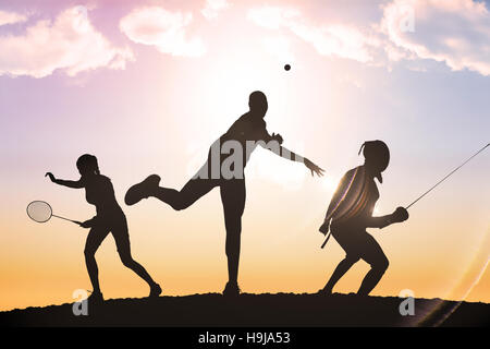 Composite image of rear view of man throwing javeline against white background - Stock Photo