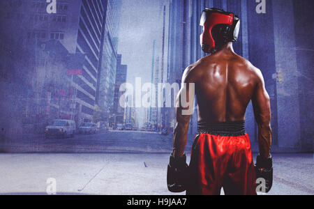 Composite image of rear view of boxer standing - Stock Photo