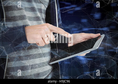 Composite image of cropped image of man using tablet - Stock Photo