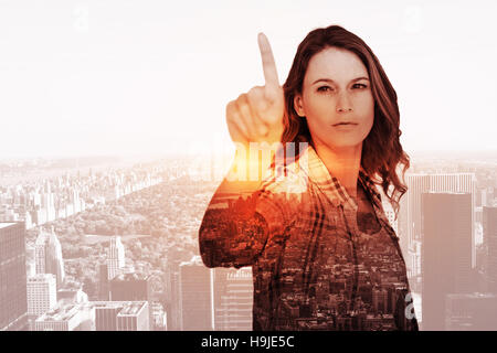 Composite image of concentrated pretty hipster pointing - Stock Photo