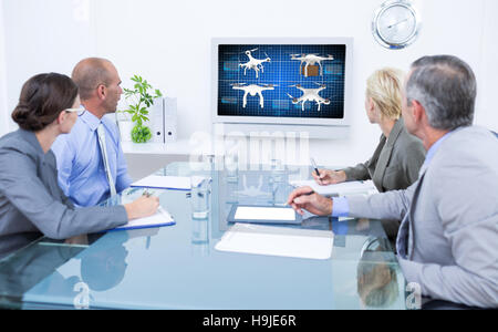 Composite image of business team looking at time clock - Stock Photo