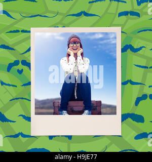 Composite image of smiling hipster woman sitting on suitcase - Stock Photo