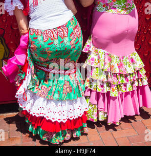 Two Spanish women in tight Flamenco dresses. Spain - Stock Photo