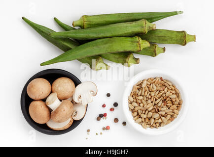 Okras ,Mushrooms ,Sunflower seeds and Peppercorns ,Ingredients for Okra Stir fry, - Stock Photo
