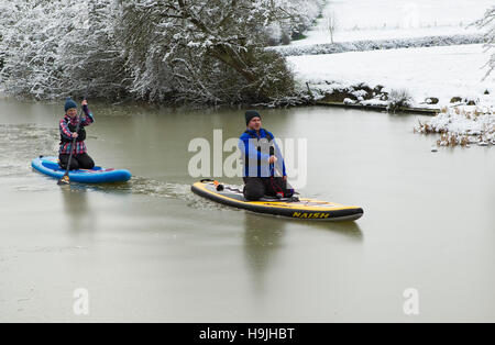 Paddle boarding on the icy Grand Union Canal at Foxton locks - Stock Photo
