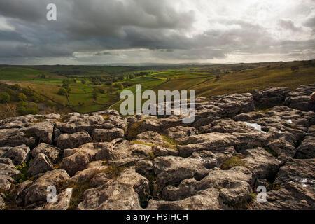 View from Malham cove limestone pavement - Stock Photo