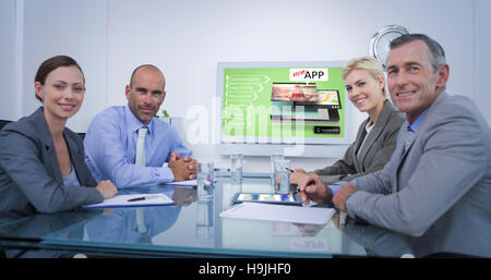 Composite image of business team looking at white screen - Stock Photo