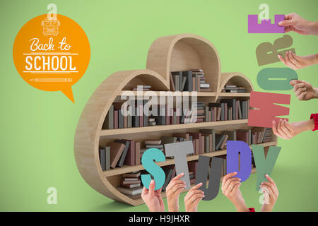 Composite image of colorful alphabet spelling study more held up by people - Stock Photo