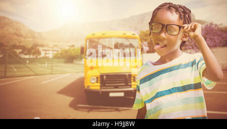 Composite image of young boy holding eyeglasses - Stock Photo