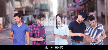 Composite image of handsome man text messaging through smart phone - Stock Photo