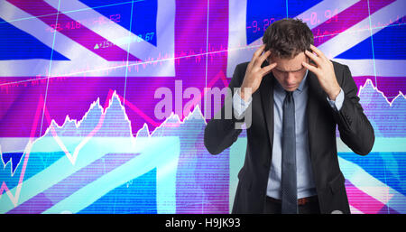 Composite image of stressed businessman with hands on head - Stock Photo