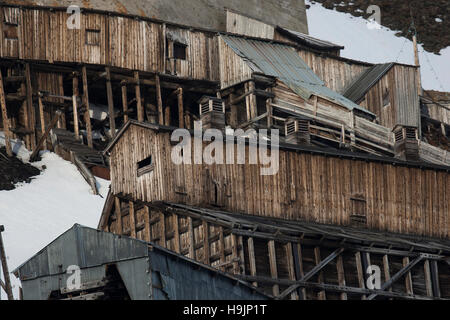 Dilapidated buildings of abandoned former coal mine at Longyearbyen, Svalbard / Spitsbergen - Stock Photo