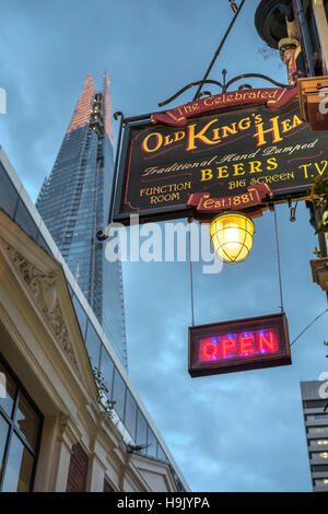 Old King's head Traditional English pub sign with the Shard skyscraper in the background, Borough High Street,London,England - Stock Photo