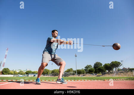 Athlete performing a hammer throw - Stock Photo