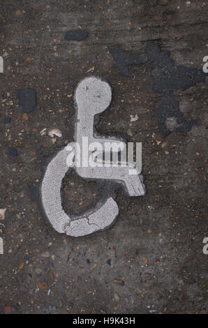 Disabled sign painted on tarmac road surface - Stock Photo