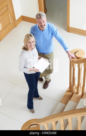 Mature Couple Looking Around House For Sale - Stock Photo