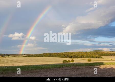 A double rainbow over the Dorset countryside. - Stock Photo