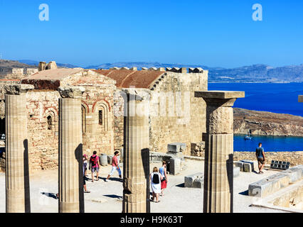 Panoramic view of Lindos Acropolis with blue bay beneath, Rhodes Island, Greece - Stock Photo