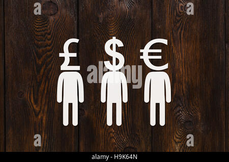Paper men with money signs, abstract conceptual image - Stock Photo