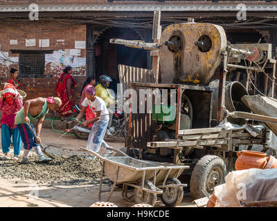 Men doing repaid work in the street-Bhaktapur, Nepal - Stock Photo