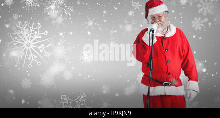 Composite image of santa claus singing songs against white background - Stock Photo