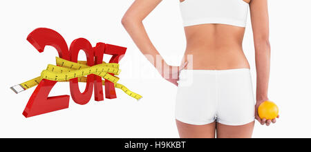 3D Composite image of rear view of female slender body in shorts - Stock Photo
