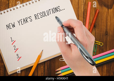 Composite image of businesswomans hand writing with pen - Stock Photo