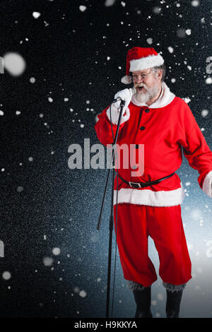 Composite image of santa claus singing christmas songs - Stock Photo
