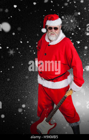 Composite image of smiling santa claus standing with guitar - Stock Photo