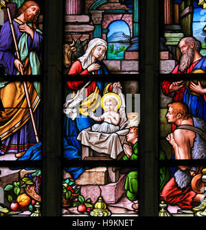 Nativity Scene at Christmas, stained glass window in Saint James church of Stockholm, Sweden. - Stock Photo