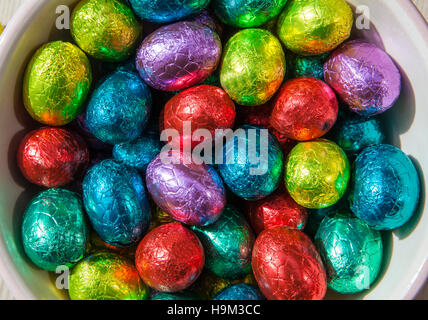 Conceptual close up photo of chocolate easter eggs wrapped in coloured foil - Stock Photo