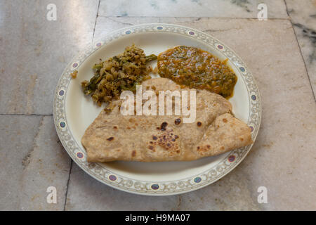 Indian breakfast meal consisting of Roti(Flat Bread),Cabbage Curry and Dal(Lentil) - Stock Photo